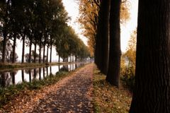 BIKE PAD ALONG CANAL L`ESPIERRES IN THE VILLAGE SAINT LEGER BELGIUM Stock Photos