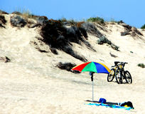 Bike and parasol Royalty Free Stock Images