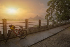 Bike park by river in summer with beautiful sky in nature mornin Royalty Free Stock Photo