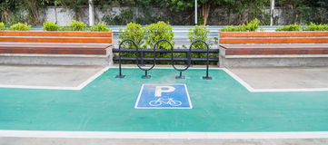 Bike park sign on concrete lane with sitting places. Bike park sign on concrete lane with sitting place Royalty Free Stock Image