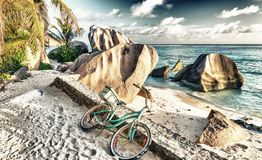 Bike parked on a beautiful tropical beach. Holiday concept.  Stock Photo