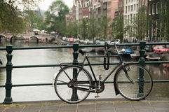 Bike parked on a bridge Stock Images