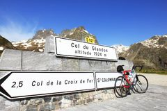 Bike, parked at the Col Glandon, France. Col du Glandon is a high mountain pass in the Dauphin` Alps in french Savoie, linking Le Bourg-d`Oisans to La Chambre royalty free stock photo