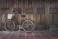 Bike parked near an ancient house in Vietnam royalty free stock photos