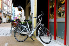 Bike is parked near  shop Royalty Free Stock Images