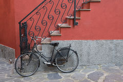 Bike parked near stairs of home. Stock Photo