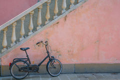 Bike parked near stairs of home. Royalty Free Stock Photo