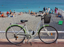 Bike Parked next to a Pebble Beach Stock Image