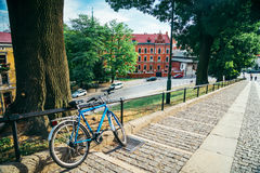 Bike parked outside on the street. In sunny day Royalty Free Stock Photo
