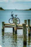 Bike parked on a pier on Ocracoke Island, NC Stock Images