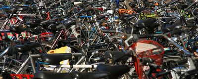 Bicycles. Parked on a sidewalk Stock Photos
