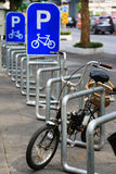 Bike Parking Lot with the bicycle. Parking sign Stock Images