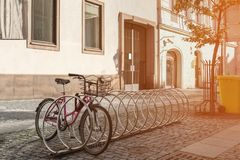 The bike is in the Parking lot on a city street on a Sunny day. Royalty Free Stock Photos