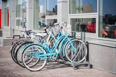 Bike parking near modern building. A healthy lifestyle, a walk on the bike. Stock Photo