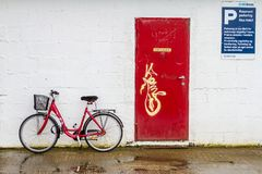 Bike on a parking. A red bike parked on a parking in Norway Stock Images