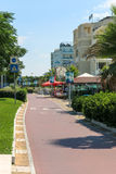 Bike path along the pedestrian street Lungomare della Repubblica. A bike path located on the street along the hotels on the coast Stock Photos