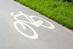 Bike path in city with sign Royalty Free Stock Photo