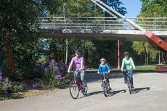Bike Path with DeFazio Bridge. A young family ride along the bike path at Alton Baker Park by the DeFazio bike bridge in Eugene Oregon stock photos