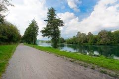 Bike path follows the river Adda Royalty Free Stock Photos