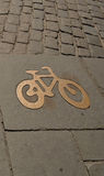 Bike path, in gold. Background, texture. Sign of cycle track in Stockholm Royalty Free Stock Photo