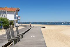 Arcachon, France, bike path at seafront. A bike path with public benches runs along the beach of Arcachon, a famous seaside resort in France Stock Image