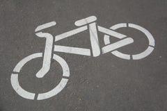 Bike Path. Sign bicycle lane Photo Damage white paint on asphalt Stock Images