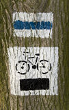 Bike path sign on tree Royalty Free Stock Photos