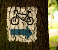 Bike path. Sign bike path in the woods Royalty Free Stock Photo