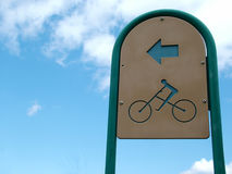 Bike Path in the Sky. Bike Path directional sign, against blue sky Royalty Free Stock Photos