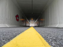 Bike Path Tunnel 2. Bike path tunnel with line in wintertime Royalty Free Stock Image