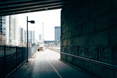 Bike path under an overpass in Philadelphia, Pennsylvania. Royalty Free Stock Photos