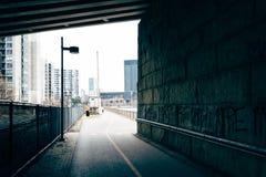 Bike path under an overpass in Philadelphia, Pennsylvania. Royalty Free Stock Photos