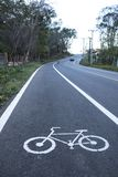 Bike pathway. White painted sign for bike path for Uphill climb Royalty Free Stock Image