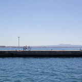 Bike on pier against sea and blue sky Stock Photography