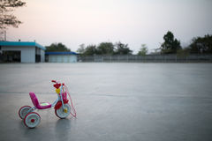 Bike plastic toys for kids. At sun set Royalty Free Stock Image