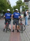 Bike Police. Two German police officers on bikes patrolling the streets of Hanover Germany Royalty Free Stock Photos