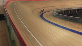 Bike Pursuit in velodrome sequence stock video footage