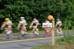 Bike Race. Bikes traveling past a mail box at high speeds Stock Images
