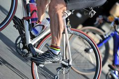 Bike race. Leg of caucasian cyclist participating in a bike race Stock Photo