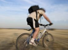 Bike race. A mountain bike cyclist in a middle of a race in rural area Stock Images