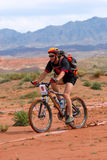 Bike race in desert mountains Stock Photography
