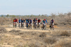 Bike race on desert road Stock Photography