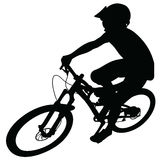 Bike race on a mountain slope -- silhouette Royalty Free Stock Photos