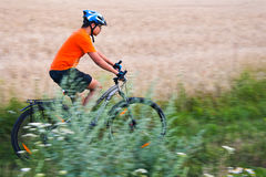 Bike race near field. Shot with low shutter speed to achieve motion blur Stock Photography