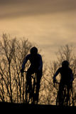 Bike racer. Silhouette of two bike racers Royalty Free Stock Photography