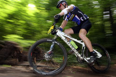 Bike racer. Worn out biker on cross contry race. MTB fanatic, Novi Sad Royalty Free Stock Photos