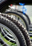 Bike rack. Close-up of a schoolyard bicycle rack detail on the tire tread Stock Image