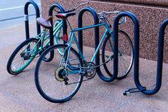 Bike rack with bikes on street Royalty Free Stock Photo