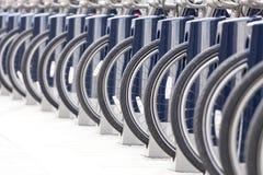Bike rack, city bike rental on the street in the city. Bike rack, city bike rental on the street in the city Stock Photography