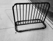Empty bike rack. An empty bike rack on a sidewalk. It's a typical scene in an urban situation Royalty Free Stock Photography